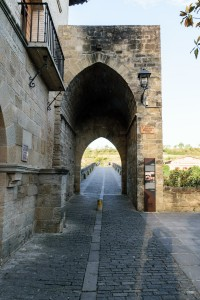 Passing through arch leading to the pilgrim bridge (Queen's Bridge) leaving Puenta la Reina