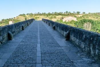 Crossing the pilgrim bridge (Queen's Bridge) on the way out of Puente la Reina