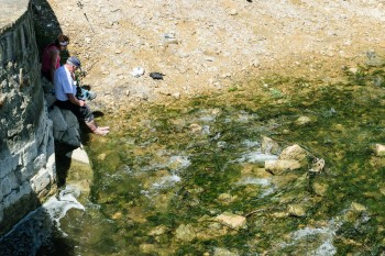 Pilgrims soaking their feet in the Salt River
