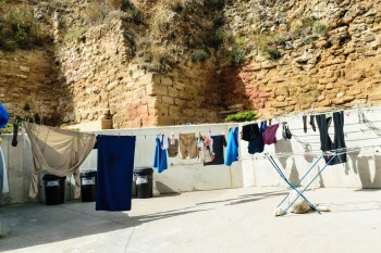 Our clothes, hanging next to a remnant of the city wall dating back to the late 11th century