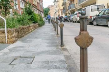 Sidewalk trail markers in Estella