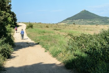 Walking the scenic route with ruins of St. Stephen's Castle on nearby hilltop