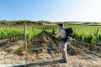 Steve taking walk-by video of a vineyard