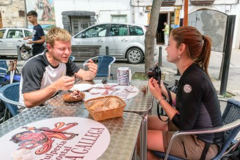 Robert (Germany) and Kelly (Brazil) eating octopus with us
